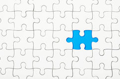 White jigsaw puzzles. White jigsaw puzzle on blue background royalty free stock images