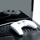 White joystick. Joystick is on the laptop royalty free stock photography