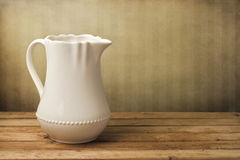 White jug on wooden table Stock Photo