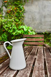 A white jug on the wooden table Royalty Free Stock Photo