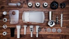 White juicer Parts on Brown Wooden Table Stock Photos