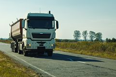 White Kamaz on the road. stock photos