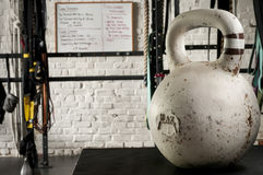 White Kettlebell on a gym floor Stock Image