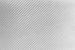 White kevlar carbon fiber texture. Background Royalty Free Stock Image