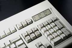 White keyboard. Closeup of a white computer keyboard on the black background Royalty Free Stock Photography