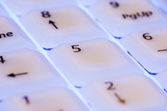 White keyboard with blue light close up Royalty Free Stock Images