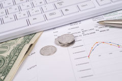 White keyboard with dollars and coins Royalty Free Stock Photos