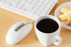 White keyboard and mouse with cup of black coffee Royalty Free Stock Photo
