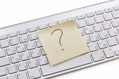 White keyboard sticky note. White keyboard with question mark on sticky note royalty free stock image