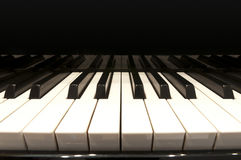 White keys of a grand piano. White and black keys of concert grand piano stock photos