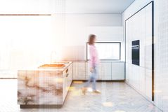 White kichen, marble bar blur. White and marble kitchen interior with a white wooden floor, white walls, panoramic windows and a bar stand. 3d rendering mock up stock illustration