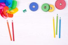 Kid`s desk with colorful pencils and toys, top view with copy space Stock Images
