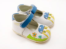 White kid's shoes with hook-and-loop, isolated. White kid's shoes with hook-and-loop for the little girl, isolated Royalty Free Stock Image
