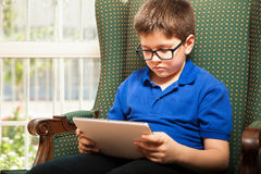 White kid using a tablet Royalty Free Stock Photography