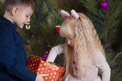 White Kids Preparing Christmas Tree with Balls Royalty Free Stock Image