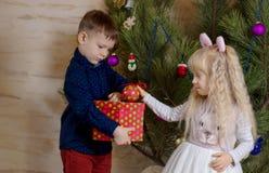 White Kids Preparing Christmas Tree with Balls Royalty Free Stock Photo