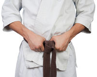 White kimono belt edge. In hands Royalty Free Stock Image
