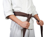 White kimono belt edge in hands Stock Photography