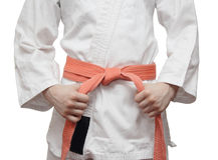 White kimono and an orange belt Stock Photo