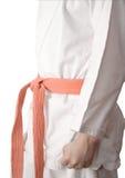 White kimono and an orange belt Stock Photography