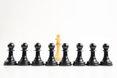 White king in front of black pawns Royalty Free Stock Photography