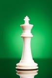 White king on green background Stock Photo