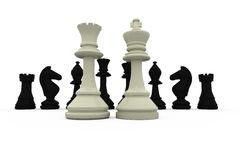 White king and queen standing in front of black pieces Stock Photography