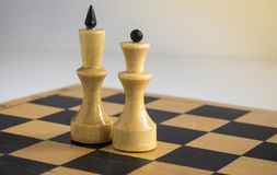 White king and Queen. On the chessboard stock photos