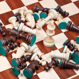 White king and scattered chess pieces Stock Photography