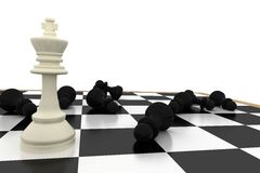 White king standing with fallen black pawns Stock Images