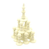 White king standing at the pyramid made of pawns Stock Image