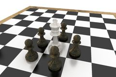 White king surrounded by black pawns Royalty Free Stock Photos