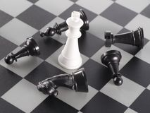 White King Surrounded by some Black Pieces. On the Chessboard Royalty Free Stock Photos