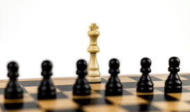 White King under Threat. White king surrounded by black pawns Royalty Free Stock Photography