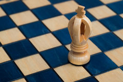 White king on wooden chessboard Stock Photography