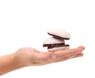 White Kiss Cookies with chocolate in hand. Royalty Free Stock Photos