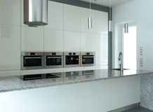 White kitchen with built-in appliances Stock Photos