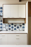 White kitchen cabinet in modern home with blue tile Royalty Free Stock Photos