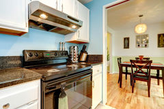 White kitchen cabinets with black stove Stock Photos
