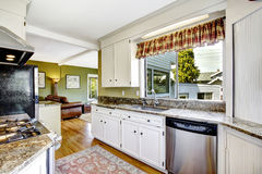 White kitchen cabinets with granite tops Royalty Free Stock Photos