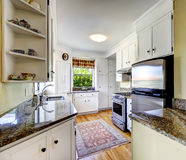 White kitchen cabinets with granite tops Stock Images