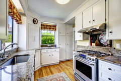 White kitchen cabinets with granite tops Stock Photography