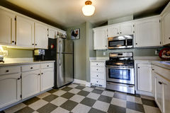 White kitchen cabinets and steel appliances. Royalty Free Stock Photos