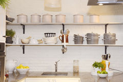 White Kitchen, Colorful Fruits on Granite Counter, Pots and Plates on Shelves