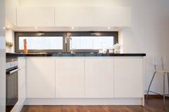 White kitchen cupboards. Modern kitchen interior with white kitchen cupboards stock photography