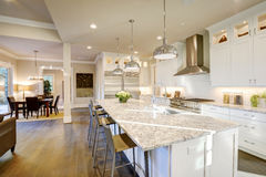 White kitchen design in new luxurious home Royalty Free Stock Image