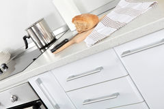 White kitchen detail - with cutting kitchen board, bread, fabric Royalty Free Stock Photos