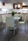 White kitchen and dining room Stock Photography