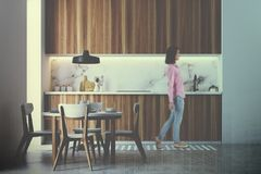 Wooden kitchen interior, round table toned stock image