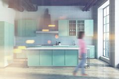 White kitchen, green countertops blur. White kitchen interior with a wooden floor and green countertops. A woman. 3d rendering mock up toned image blurred Stock Photo
